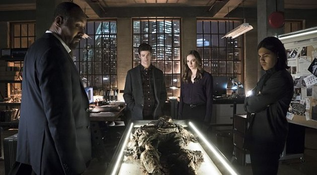 Barry, Joe, Caitlin, and Cisco with Harrison Wells' remains