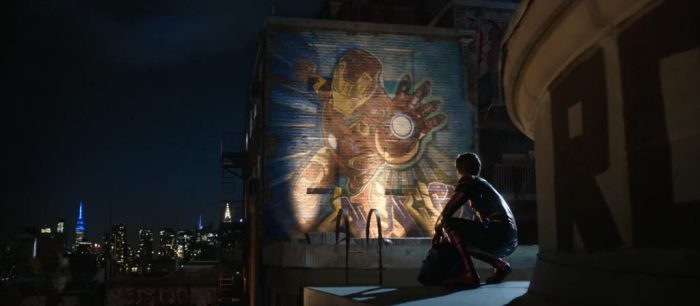 Spider-Man looking at a mural of Iron Man